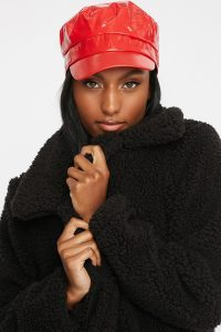 women patent cabbie hat